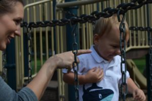 Mom and son on playscape