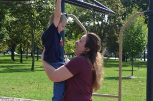 Mom with son on monkey bars
